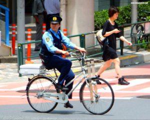policeman on a bike